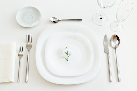 white place setting with little flower Stock Photo