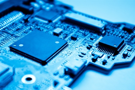 pcb: electronic circuit with shallow depth of field - blue toned