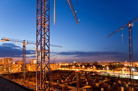 construction sites: construction site with cranes at dusk Stock Photo