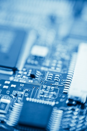 modern electronics with shallow depth of field blue toned