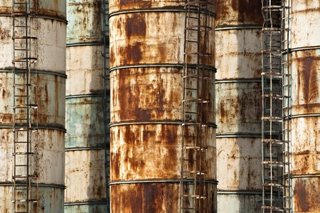 abandoned factory: old rusty industrial containers for background