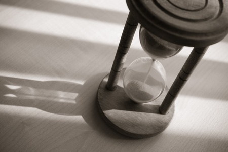 time concept with vintage hourglass photo