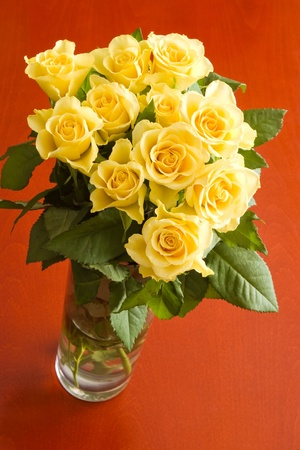 yellow roses: yellow roses bouquet on red table