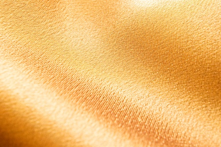 abstract golden background from fabric with shallow depth of field photo