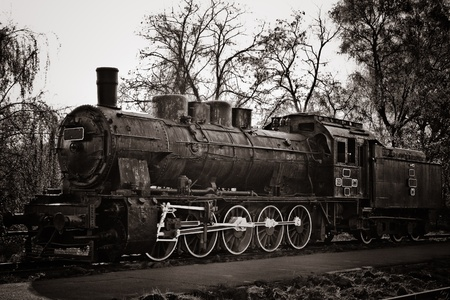 vintage steam locomotive in warm balck and white photo