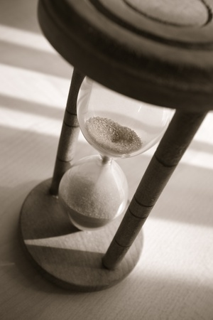 time concept with old hourglass in warm balck and white photo