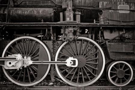 black train: old locomotive wheel detail in warm black and white