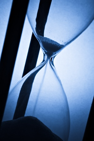 detail of hourglass on blue photo