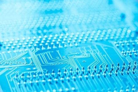 pcb: circuit board blue toned with shallow depth of filed Stock Photo