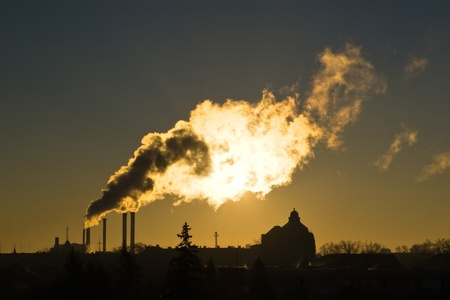 silhouette of industrial smoke in morning light photo