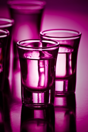 alcoholic beverage: drinks on purple with shallow depth of field Stock Photo