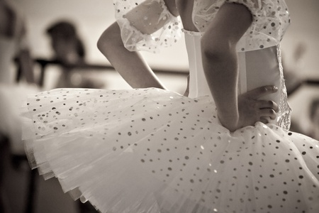 young ballet dancer in sepia tone photo
