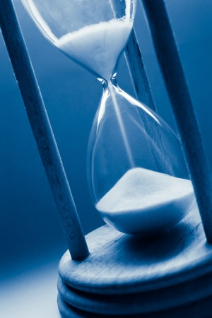 hour glasses: time concept with hourglass in blue tint