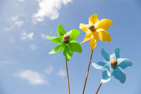 three pinwheels on sky with few clouds