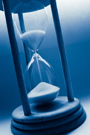 aging concept: time concept with hourglass blue tinted