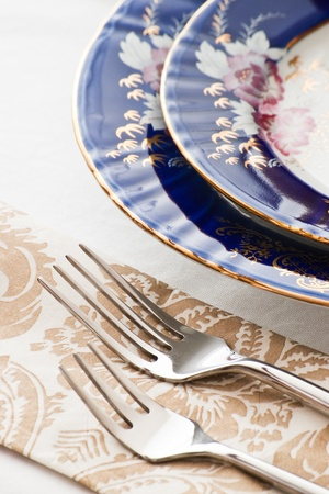 dinnerware: two forks and fine porcelain plates