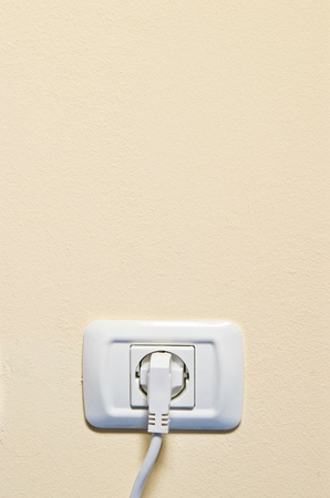 electric consumption - one socket on beige wall photo
