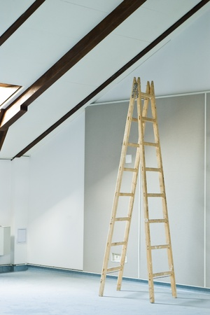 construction interior with stepladder and wall photo