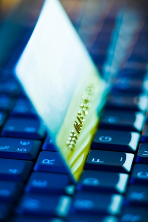 closeup shot of credit card on keyboard photo