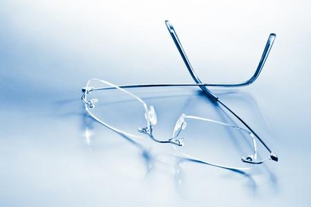 eyeglasses with reflection blue toned photo