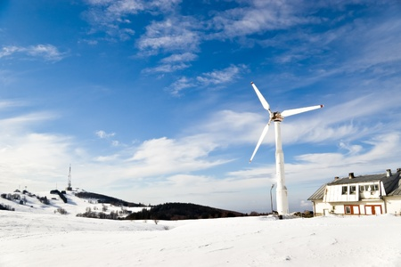 wind turbine on mountain winter landscape photo
