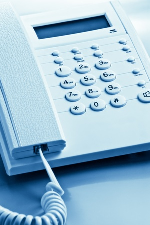 contact center: closeup of telephone blue toned Stock Photo