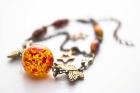 bracelet with amber on white with shallow depth of field photo