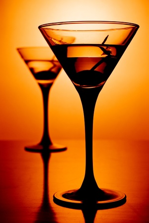 coctail: martini glasses on hot background