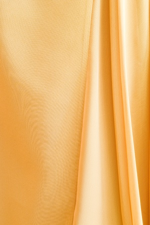 flowing golden fabric for background photo
