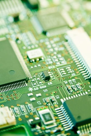 pcb: modern electronics with shallow depth of field in green