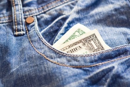 one dollar in blue jeans pocket photo