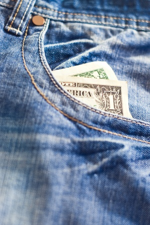one dollar in jeans pocket with shallow depth of field photo