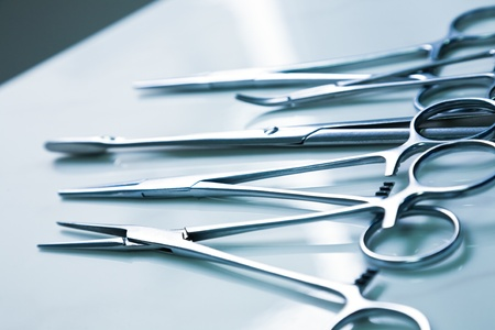 surgical tool: medical clamp instruments on table Stock Photo