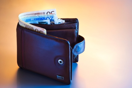 wallet with euros in blue and orange light photo