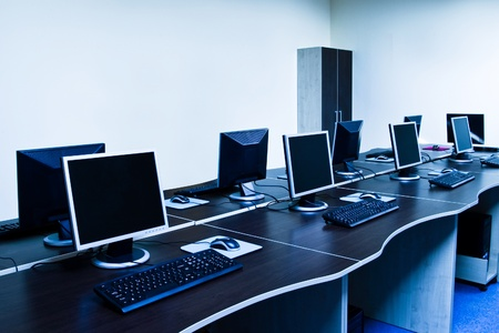 office with modern computers blue toned