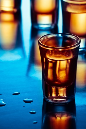 alcoholic: tequila drink on tap room in blue light Stock Photo