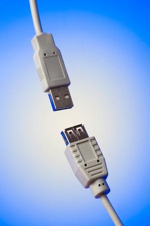 closeup shot of two usb connectors on blue