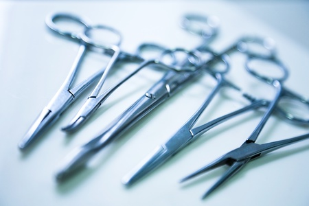 surgical tools: medical clamp instruments on table with shallow depth of field