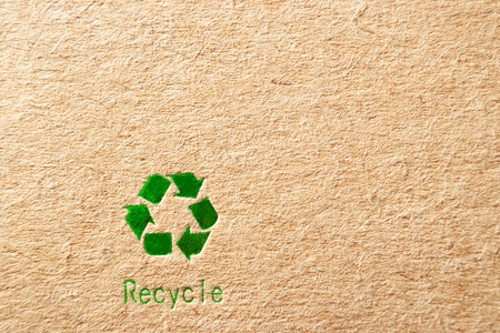 cardboard box background with green recycle symbol photo