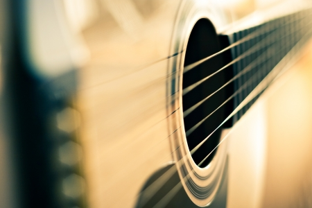 western saddle: detail of classic guitar with shallow depth of field