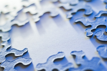 puzzling: puzzle pieces with copy space and shallow depth of field in blue light Stock Photo