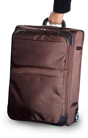 wheeled: brown wheeled luggage isolated on white