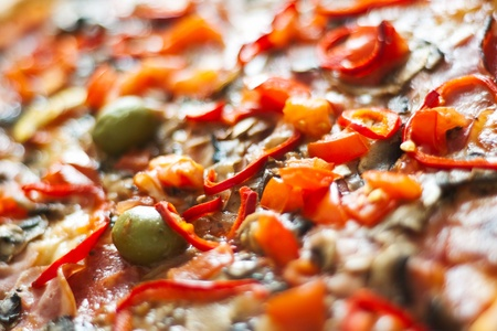 closeup of pizza with pepper and olives photo