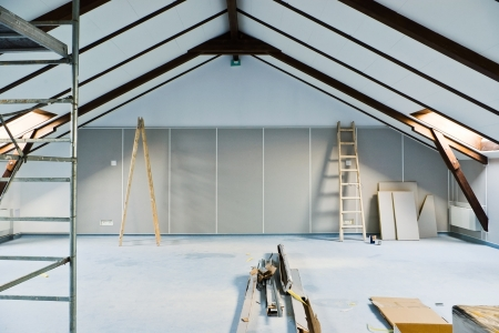 restoration: attic renovations with ladder and gray walls Stock Photo