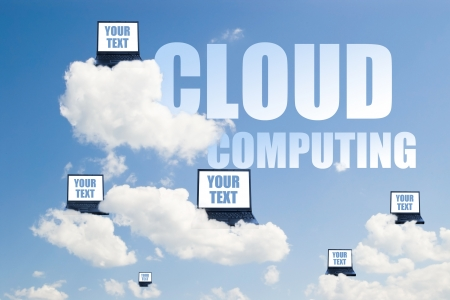 concept of cloud computing with laptops on clouds photo