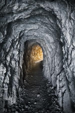 old tunnel through mountain rock Stock Photo