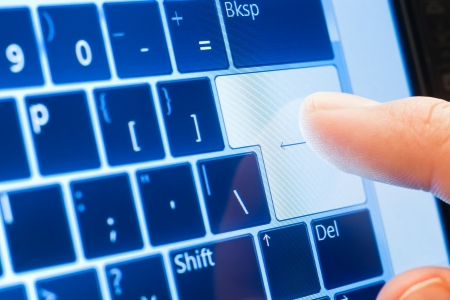 computer user: finger push enter on touch screen virtual keyboard Stock Photo