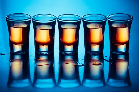 five hot drink shots with reflection in bar photo