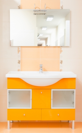 bathroom with peach color furniture sink and mirror Stock Photo - 13819723