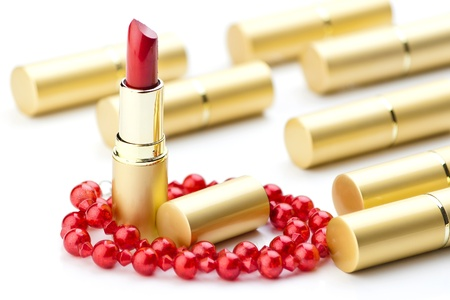 golden lipsticks and red jewelry Stock Photo - 13819696